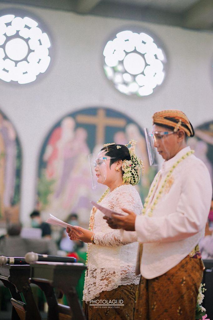 Holy Matrimony / Pemberkatan for Yinta + Adi by Photolagi.id - 014