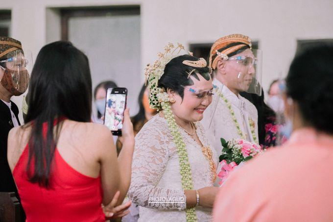 Holy Matrimony / Pemberkatan for Yinta + Adi by Photolagi.id - 001