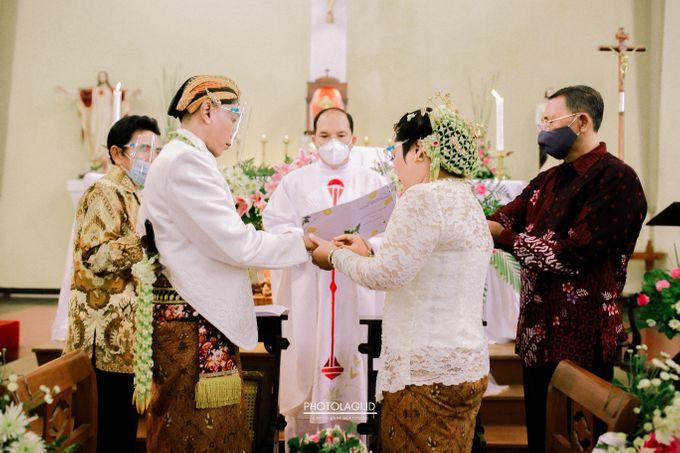 Holy Matrimony / Pemberkatan for Yinta + Adi by Photolagi.id - 017