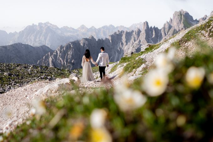 Pre-wedding shoot of Indonesian couple in Tre Cime Mountains and Lago di Braies, - the most beautiful lake of Dolomites in Italy. by Fotomagoria - 019