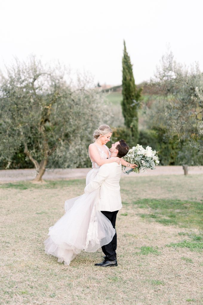 Erica and Nick's wedding in Tuscany was shot during Lauren Fair and Julie Paisley workshop in Tuscany this spring. The theme of the wedding was white  by Katka Koncal - 031