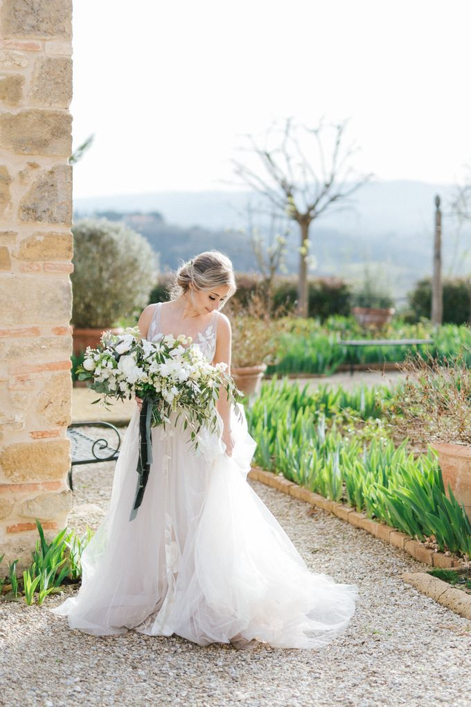 Erica and Nick's wedding in Tuscany was shot during Lauren Fair and Julie Paisley workshop in Tuscany this spring. The theme of the wedding was white  by Katka Koncal - 018