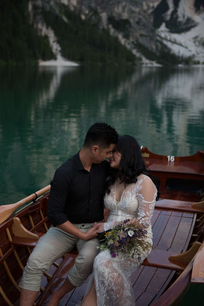 Pre-wedding shoot of Indonesian couple in Tre Cime Mountains and Lago di Braies, - the most beautiful lake of Dolomites in Italy. by Fotomagoria - 025