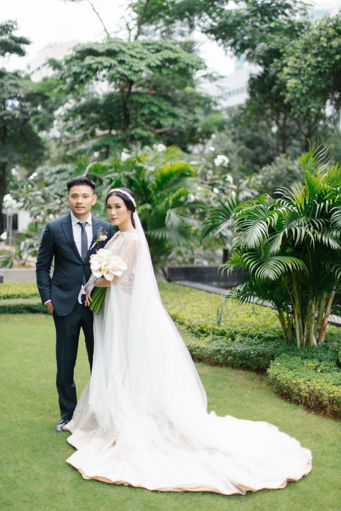 The Wedding Of Sandhy & Sylvani by de_Puzzle Event Management - 025