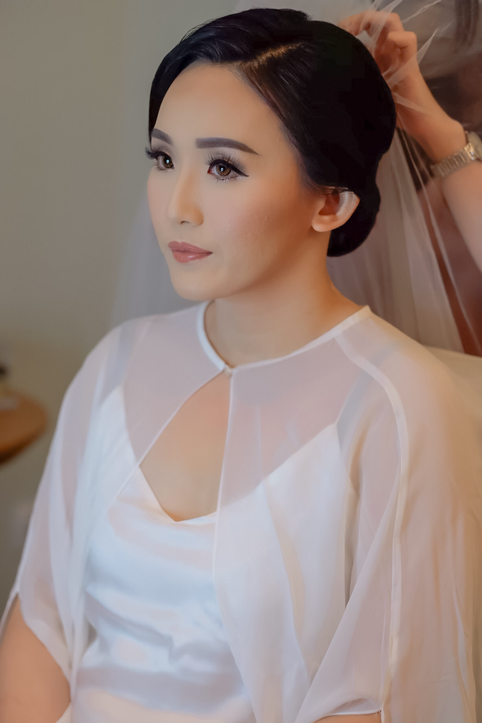 wedding makeup n hairdo for ariyanti by tanmell makeup - 002