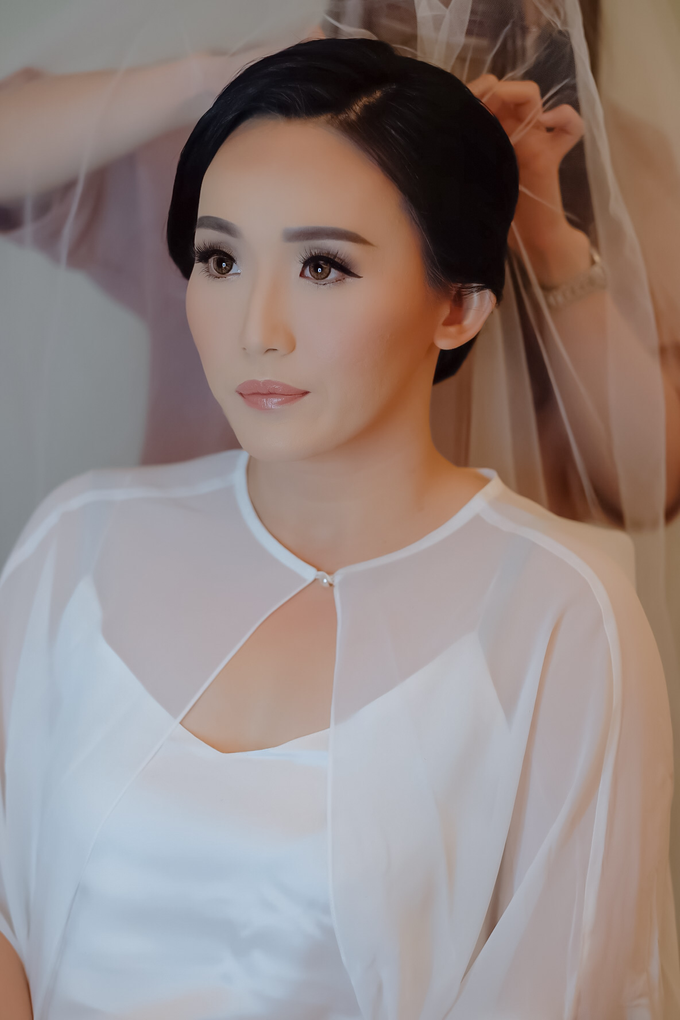 wedding makeup n hairdo for ariyanti by tanmell makeup - 004