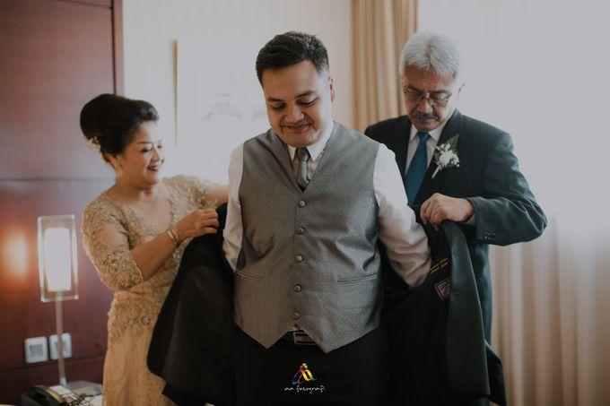 Pernikahan dua budaya ala Andreas dan Herly by theSerenade Organizer - 003