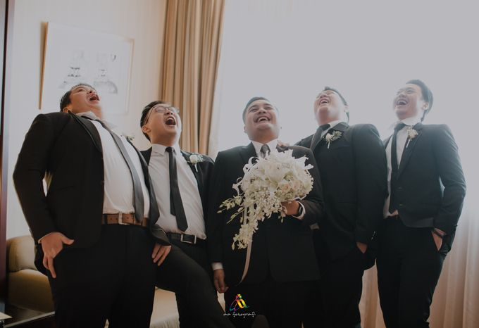 Pernikahan dua budaya ala Andreas dan Herly by theSerenade Organizer - 004