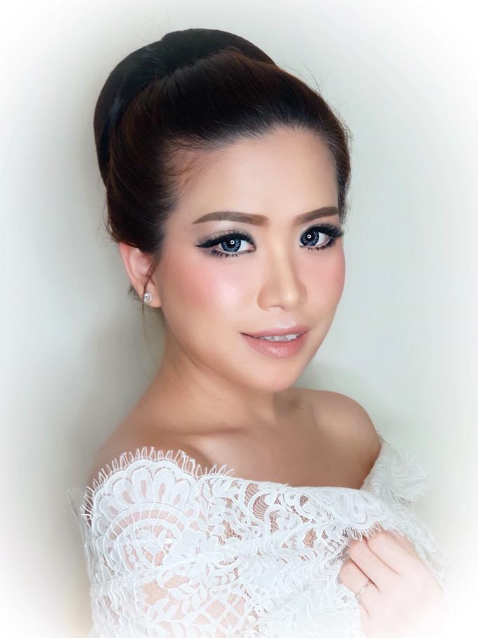 Jheni Wedding Makeup Before & After by Yurica Darmawan - 005
