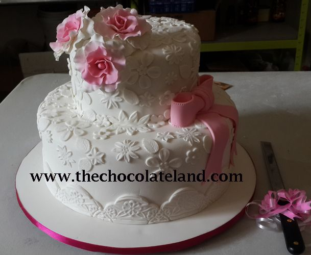 Add To Board 2 tiers wedding cake with pink and white decoration by The Chocolate Land - 001 & 2 tiers wedding cake with pink and white decoration by The Chocolate ...