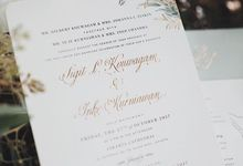This soft sage green washed colored invite combined with some gold touches creates a natural ambience with finesse by Tapestry Invitation