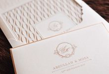 A simple yet elegant gold on creme invitation for our client in a far away country by Tapestry Invitation