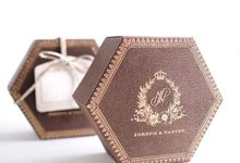 A flower themed holy matrimony invitation wrapped neatly in a hexagonal box for Joseph & Nadine by Tapestry Invitation