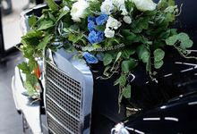 Wedding flowers for classic car  by Yulika Florist & Decor
