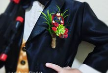 Groom Boutonnieres by ladybug florist