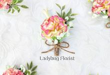 Family Boutonnieres by ladybug florist