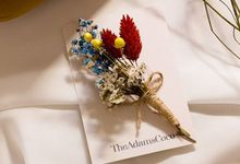 Boutonniere by The Adams Coco