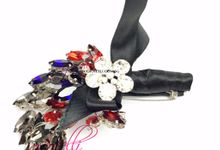 Gioielli Boutonnieres and Corsages by Gioielli Bridal Accessories & Crystal Bouquets