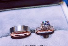 ROUND DIAMOND WITH CUSHION HALO 18K ROSE GOLD ENGAGEMENT RING WITH MATCHING MILGRAIN WEDDING BANDS by LES PRECIEUX