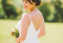 Hand beaded wedding dress with V neckline by Kelly's Bridals