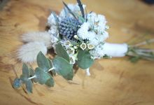 Corsage grooms by Rhea flowers shop