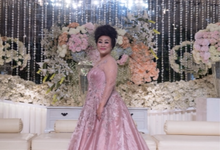 Groom and bride family-pastel colors gowns by Boenga Bridal Couture