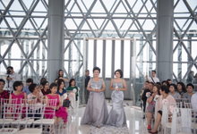 Groom and bride family-pastel colors gowns by Boenga Couture