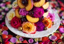 Magical Tower of fruits flowers confectionary by Cake & Wildflour