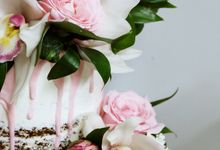 Semi Naked 2 Tiered Cake with Pink Floral Combination by KAIA Cakes & Co.