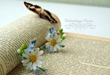 Daisy earrings by Mirobell