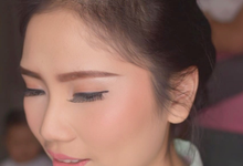 Party makeup with messy up do by Fenty Senjaya Makeup Artist