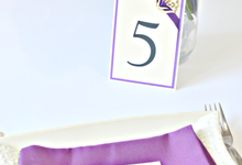 Purple place cards and table numbers by Jasmine wedding prints