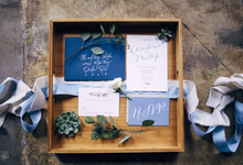 Earthy Blue and Green Wedding Invitation by Brown Fox Creative