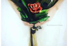 A handheld bouquet with a difference... by Alchemist Infinite Pte. Ltd