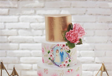 Handpainted watercolor floral wedding cake by Creme de la Creme Bali
