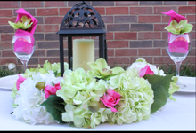 Centerpieces by Enchanting Events & Decor