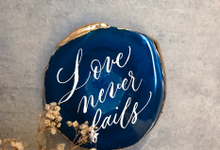 Lettering on agate stone by Grace and Truly Calligraphy