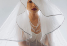 "Rinni Whulandari wearing ""White Cursed"" by Howard laurent"