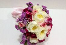 Hand Bouquet by Line Roses Florist & Choco