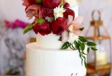 Buttercream 2 Tiered cake with Red Flower Combinations & Cupcakes by KAIA Cakes & Co.
