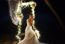 Fairylights Draps Across Rustic Branches Arch by Victoria Wedding Collection