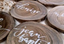 Customized wooden coasters as placecards by Eunike Arts & Calligraphy