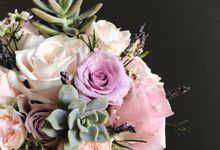 Succulents in bridal flowers  by Eufloria