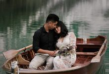 Pre-wedding shoot of Indonesian couple in Tre Cime Mountains and Lago di Braies, - the most beautiful lake of Dolomites in Italy. by Fotomagoria