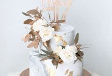 Two Tiered Grey Marble and Gold Details by KAIA Cakes & Co.