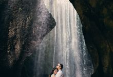 Enchanting Waterfall Session in Bali by fire, wood & earth