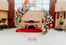 Round arch for stage backdrop  by Lavender Love Florist