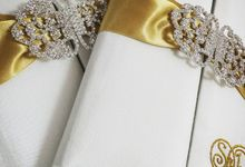 Monogram embroidered luxury wedding invitation design featuring silk and rhinestone clasp by Prestige Creations Co.,Ltd.