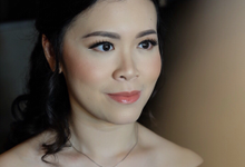 Makeup and hairdo at Singapore by Rachel Liem Makeup