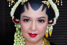 Makeup hairdo bride traditional for mrs . juniza  by Rose Makeupartist